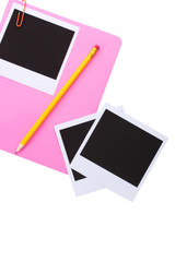 Photo papers and pink notebook isolated on white