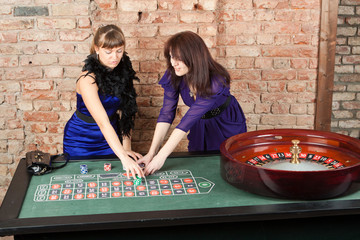Blonde girl and brunette girl in a casino