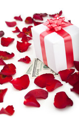 Gift box, rose petals on white background.