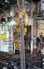 chains hanging from a hoist in workshop