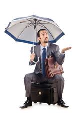 Businessman with umbrella on white