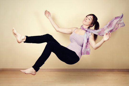 Young woman levitating