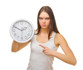 Young angry girl with clocks