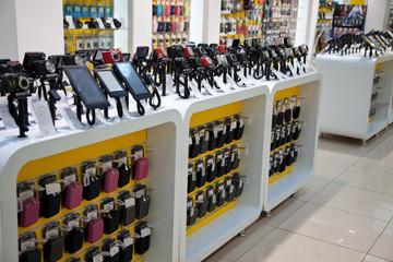 Digital cameras and mobil phones in store