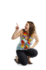 Cheerful young female pointing towards copyspace