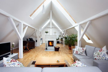 large, attractive attic room with wood-burning fireplace