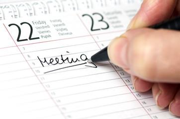 Kalender mit Eintrag Meeting