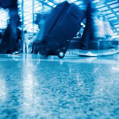 walking airport passenger with motion blur