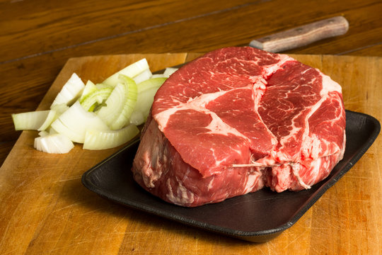 Raw Beef Chuck Roast and Onions