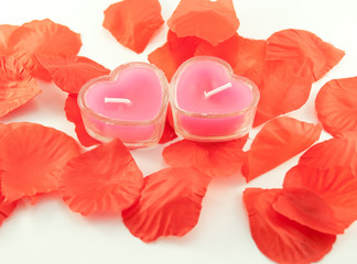 Candles in the form of hearts and tape