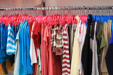 Colourful clothes on hangers