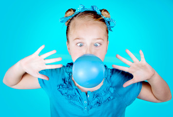 Silly girl blowing blue bubble