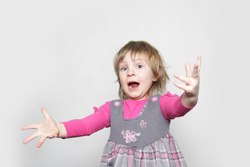 studio shot of young girl shouting