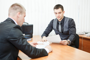 Young businessmen executives with business documents at work