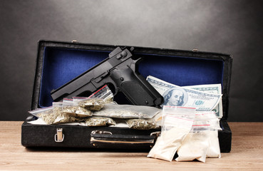 Cocaine, marijuana dollars and handgun in case