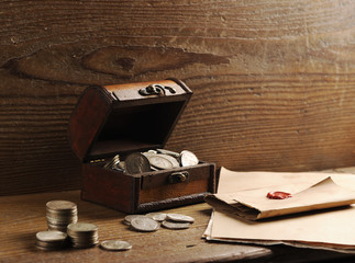 Treasure chest, old coins and mail paper