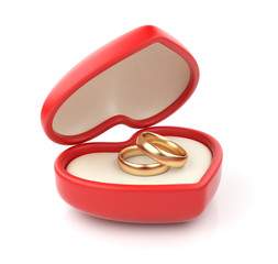 Gold wedding rings in valentine box 3D. Isolated on white backgr