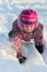Baby crawls on snow