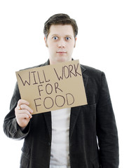 Unemployed with a sign WILL WORK FOR FOOD.