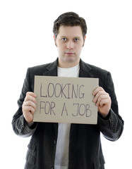 Unemployed with a sign LOOKING FOR A JOB.