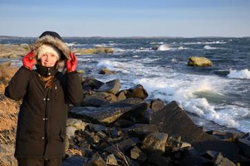 Teenager on stormy sea coast