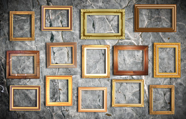golden frame on old wall .