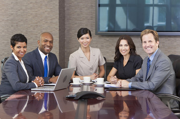 Interracial Men & Women Business Team Meeting in Boardroom