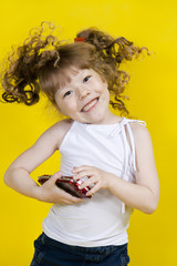 Little girl playing handheld portable game console