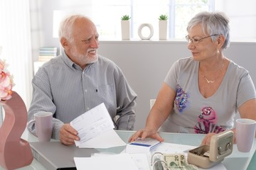 Senior couple discussing finances at home