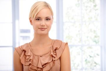 Closeup portrait of smart blonde smiling