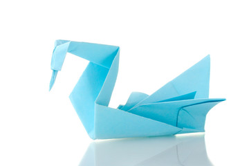 Origami swan out of the blue paper isolated on white