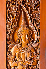 Thai style wood carving on door temple