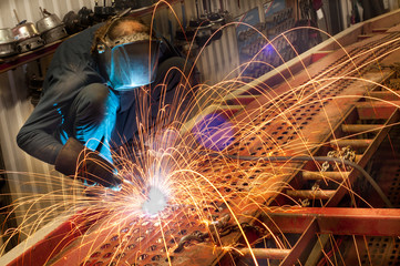 Welder Working on the Car Transport