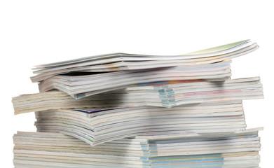 stacks of magazines isolated on white