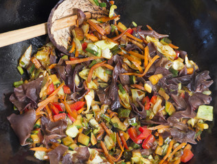 Mixing vegetable in wok