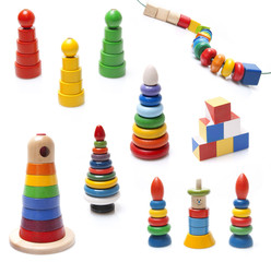 very many colorful wooden pyramidions fnd beads toy on white bac