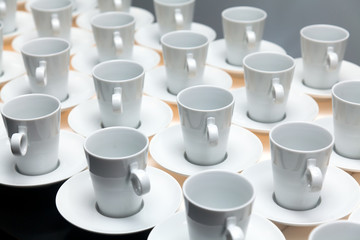 Many white coffee mugs