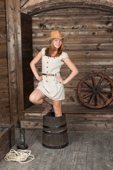 CowGirl standing in old depot