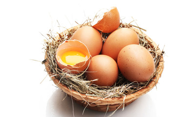 chicken eggs in a nest isolated on white