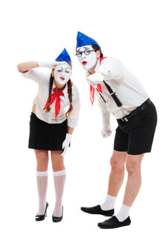 two mimes looking at something