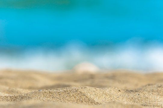 Photo of sand and ocean