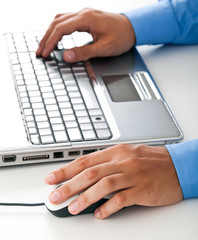 Businessman typing on the laptop