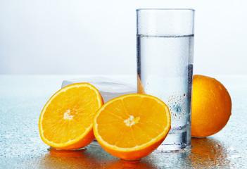 Fotoväggar - Orange slices with fresh water