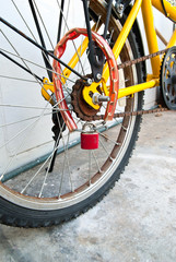 Security lock blocking the bicycle wheel