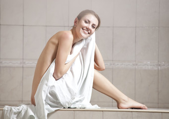 Young woman enjoying hamam or turkish bath