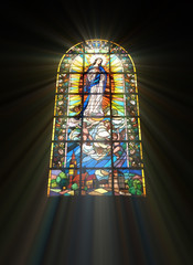Biblical stained glass with rays of light shining through