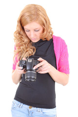 Young woman watching photos on camera