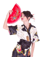 woman in Asian costume with red Asian fan