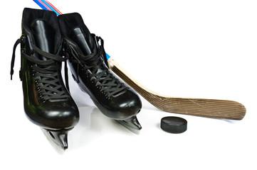 Hockey skates and stick