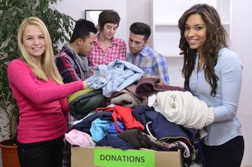 volunteer group with clothing donation